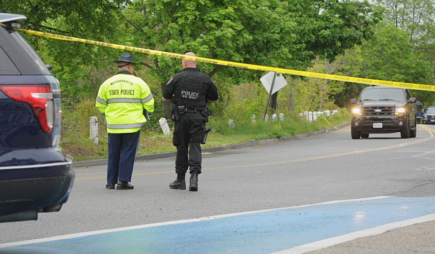 Police guard the scene on Rochdale Street near Zabelle Ave where an Auburn Police officer was shot Sunday morning May 22, 2016, in Auburn, Mass. Massachusetts State Police say in a statement that an Auburn police officer was shot at about 12:30 a.m. Sunday. Auburn is about 45 miles southwest of Boston. Officials say the officer was transported to a hospital. The identity and medical condition of officer were not immediately available. The shooting is under investigation. (Rick Cinclair/Worcester Telegram & Gazette via AP) MANDATORY CREDIT
