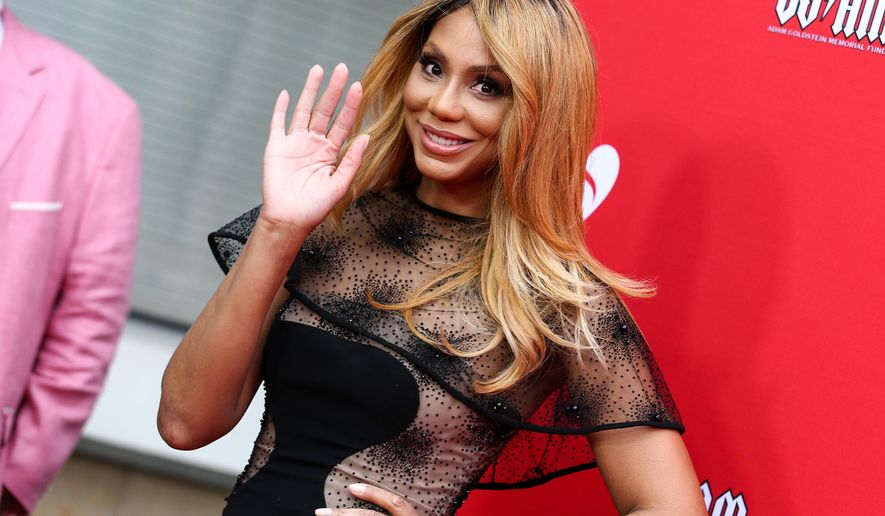 """FILE - In a Thursday, May 19, 2016, file photo, Tamar Braxton attends the 12th Annual MusiCares MAP Fund Benefit Concert held at The Novo by Microsoft on  in Los Angeles. In a statement Sunday, May 22, 2016, """"THE REAL""""/Tamar Braxton said they and Braxton """"have mutually decided that Tamar will not be continuing with the show for its upcoming third season. She will be leaving in order to concentrate on her solo career."""" (Photo by John Salangsang/Invision/AP, File)"""