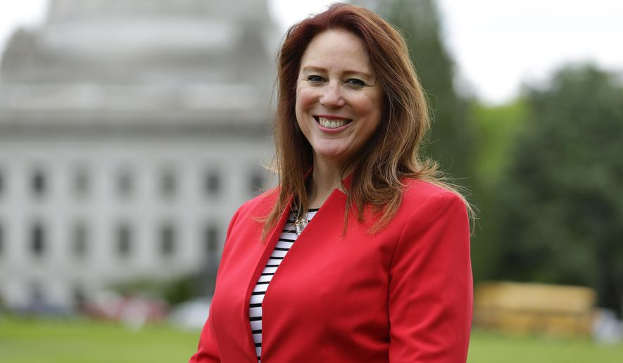In this May 4, 2016 photo, Washington Secretary of State Kim Wyman poses for a photo at the Capitol in Olympia, Wash. Wyman, the lone statewide elected Republican in Washington state, is facing Democrat Tina Podlodowski, a former Microsoft manager and adviser to Seattle Mayor Ed Murray as she seeks a second term in office. (AP Photo/Ted S. Warren)