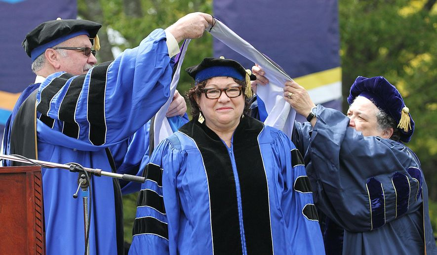 U.S. Supreme Court Justice Sonia Sotomayor receives an Honorary Doctor of Laws degree during the University of Rhode Island commencement ceremony, Sunday, May 22, 2016, in South Kingstown, R.I.  Sotomayor also spoke at the Sunday afternoon commencement ceremony. (Glenn Osmundson/The Providence Journal via AP)