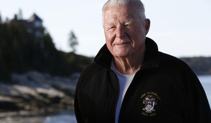 In this Friday, May 18, 2016 photo, Captain Earl Walker poses in Southport, Maine. Walker held off retirement until he had the opportunity to pilot the Navy's futuristic Zumwalt destroyer safely down the Kennebec River to the Atlantic Ocean for sea trials earlier this year. (AP Photo/Robert F. Bukaty)