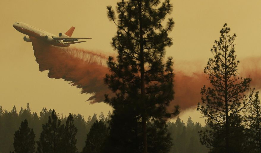FILE - In this Aug. 27, 2015 file photo, an airplane tanker flies through smoky air as it drops fire retardant on a wildfire near Omak, Wash. Washington's 2016 wildfire season got off to an abrupt and early start in May when two separate blazes tore through dry, steep forest less than 70 miles from Seattle. Officials said the recent blazes underscore a new reality in fire-prone states like Washington _ that wildfires are happening earlier in the year, and people should be prepared. (AP Photo/Ted S. Warren, file)