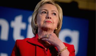 Hillary Clinton is 3 inches taller than the average American woman, according to this year's reports. (Associated Press)