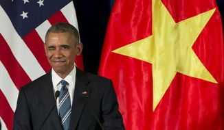 Even as President Obama was lifting a ban on arms sales to Vietnam, the communist government was arresting human rights activists. (Associated Press)