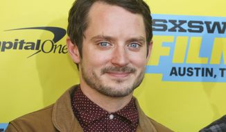"""Elijah Wood is seen at the world premiere of his new film """"The Trust"""" at the Paramount Theatre during the South by Southwest Film Festival on Sunday, March 13, 2016, in Austin, Texas. (Photo by Jack Plunkett/Invision/AP)"""