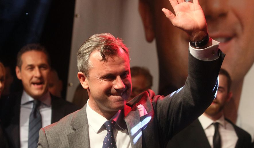 Norbert Hofer candidate for Austria's Presidency for Austria's Freedom Party, FPOE, waves during an after presidential election party in Vienna, Austria, Sunday, May 22, 2016. With all direct ballots counted in today's presidential election, both candidates, right-winger Norbert Hofer and a Greens politician Alexander Van der Bellen, had 50 percent of the vote. Nearly 900,000 absentee ballots are due to be counted tomorrow. (AP Photo/Ronald Zak)