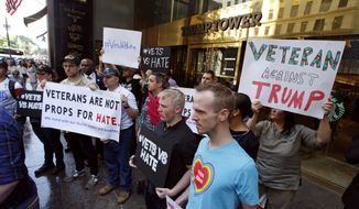 A group of local veterans protest outside Trump Tower, Monday, May 23, 2016, in New York. The veterans, who represent #VetsVsHate, are calling on Republican presidential candidate Donald Trump to apologize for failing to fulfill his long-held promise to donate the full $6 million he promised to veterans' charity organizations. Trump's campaign manager said Trump raised only 75 percent of the amount he promised when he held a fund-raiser for veterans in January 2016. (AP Photo/Kathy Willens)