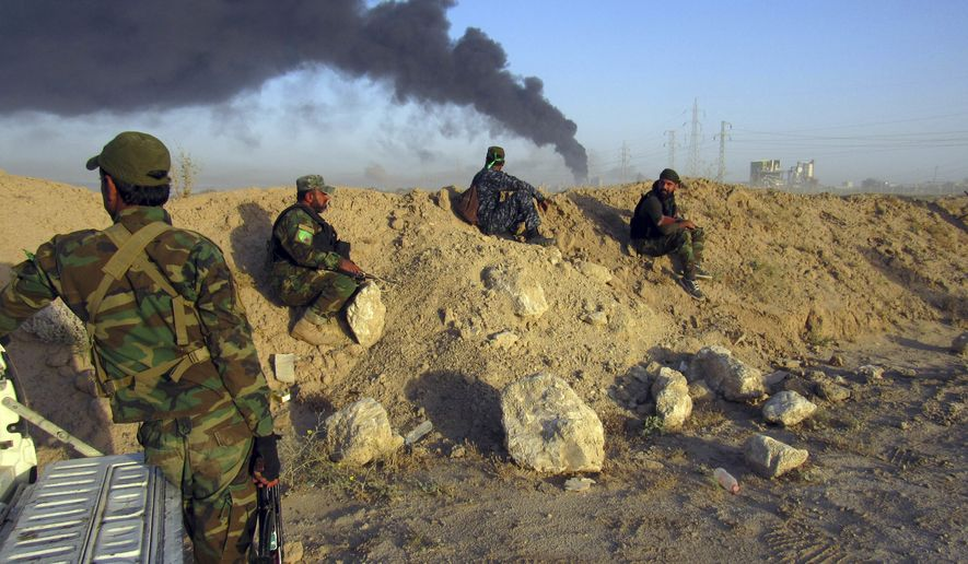Smoke rises from Islamic State group positions after an airstrike by U.S.-led coalition warplanes in Fallujah, as Iraqi security forces and allied Shiite Popular Mobilization Forces and Sunni tribal fighters, take combat positions outside Fallujah, 40 miles (65 kilometers) west of Baghdad, Iraq, Monday, May 23, 2016. Iraqi government forces on Monday pushed Islamic State militants out of some agricultural areas outside Fallujah as they launched a military offensive to recapture the city from the extremists, officials said. (AP Photo/Rwa Faisal)