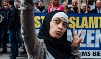 Zakia Belkhiri, the Muslim woman who shot to social media fame last week after taking a selfie in front of a group of anti-Islam protesters in Belgium, is now facing backlash for anti-Semitic comments she's made on social media. (Jurgen Augusteyns, BBC)