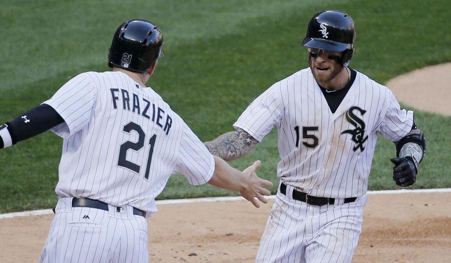 Chicago White Sox's Todd Frazier (21) greets Brett Lawrie at home after they scored on Lawrie's three-run home run off Cleveland Indians starting pitcher Mike Clevinger during the fifth inning of a baseball game Monday, May 23, 2016, in Chicago. Melky Cabrera also scored on the play. (AP Photo/Charles Rex Arbogast)