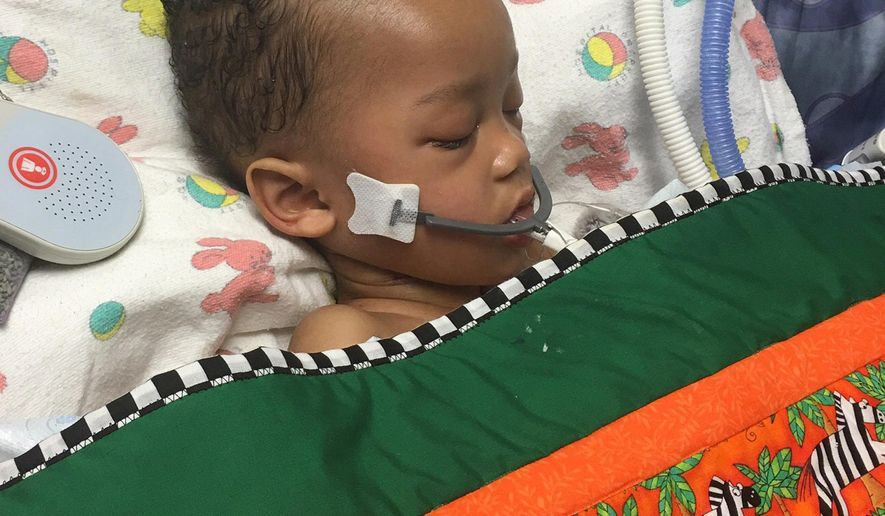 This May 12, 2016, photo provided by Alexandra Snyder shows 2-year-old Israel Stinson at Kaiser Permanente Roseville Medical Center in Roseville, Calif. The California toddler whose family waged a court battle to keep him on life support after he was declared brain dead has been transferred to another hospital. (Alexandra Snyder via AP)