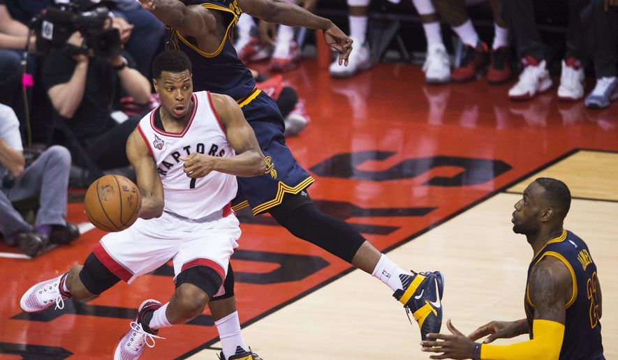 Toronto Raptors guard Kyle Lowry (7) drives around Cleveland Cavaliers center Tristan Thompson (13) as Cavaliers forward LeBron James (23) look on during first half Eastern Conference final playoff basketball action in Toronto on Monday, May 23, 2016. (Nathan Denette/The Canadian Press via AP) MANDATORY CREDIT