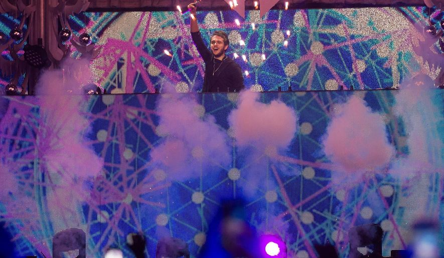 FILE - In this Dec. 11, 2015 file photo, Zedd performs at Z100's iHeartRadio Jingle Ball 2015 in New York. Zedd, The Chainsmokers, Tiesto, Kaskade, Paul Oakenfold and Martin Garrix will perform at the 20th annual Electric Daisy Carnival in Las Vegas on June 17-19. (Photo by Charles Sykes/Invision/AP, File)