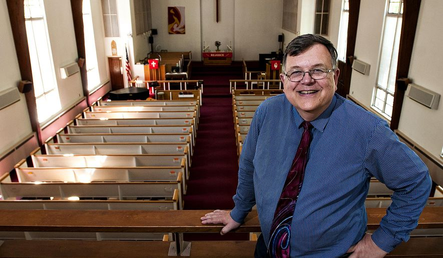 In this Monday, May 16, 2016 photo, Rev. Don Keller of Scottsville United Methodist Church in Lower Southampton, stands in the church's balcony in Langhorne, Pa. The Scottsville United Methodist Church will celebrate its 150th anniversary on Sunday, May 22, 2016. Eight former pastors are expected to attend Sunday's festivities along with the Rev. Keller - the current pastor - who grew up in the church.  (Rick Kintzel/The Intelligencer via AP) MANDATORY CREDIT