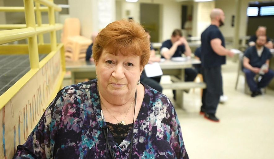 """Joanne Heinrich, who has worked as a drug and alcohol treatment specialist at the Lehigh County Jail for 18 years, poses for a photograph at the jail on April 28, 2016, in Allentown, Pa. Heinrich, who describes herself as a 78-year-old recovering alcoholic now sober for nearly 30 years, runs a therapy group for addiction issues in a section of the jail she calls the """"big cement momma,"""" where inmates serving time for nonviolent crimes spend up to 14 hours a day working on sobriety plans. (April Bartholomew/The Morning Call via AP) THE EXPRESS-TIMES OUT; WFMZ OUT; MANDATORY CREDIT"""