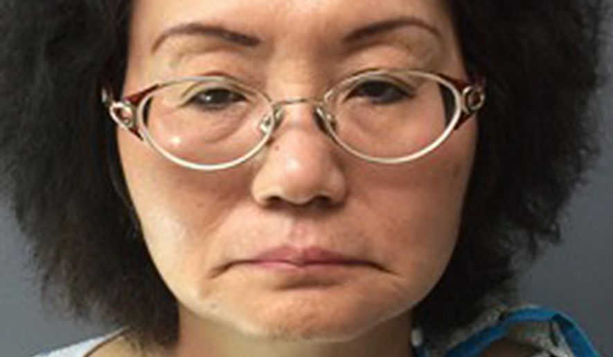 FILE - This undated file photo provided by the Montgomery County District Attorney's Office shows Hsiu-Chin Lin. Police in North Wales, Pa., and Montgomery County prosecutors say the 63-year-old woman faces first-degree murder and related charges after her ex-husband Chien-Kuo Lin, 67, collected belongings from her home in suburban Philadelphia on Sunday, May 22, 2016, and was found dead in the garage with an apparent gunshot wound to the chest. (Montgomery County District Attorney's Office via AP) MANDATORY CREDIT