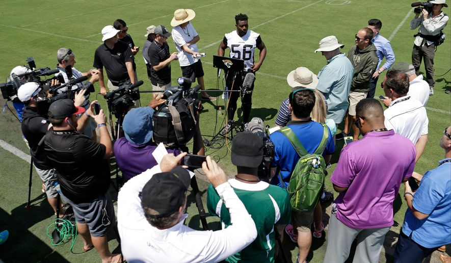 Jacksonville Jaguars defensive end Dante Fowler (56) meets with news media after the conclusion of an NFL football practice, Monday, May 23, 2016, in Jacksonville, Fla. (AP Photo/John Raoux)