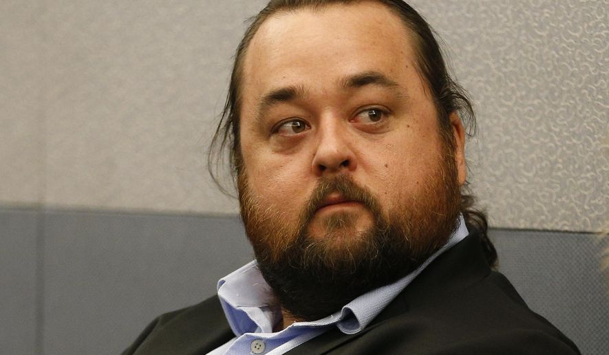 "Austin Lee Russell, better known as Chumlee from the TV series ""Pawn Stars,"" appears in court Monday, May 23, 2016, in Las Vegas. Russell and his lawyers told a Las Vegas judge he intends to plead guilty in state court to felony weapon and misdemeanor attempted drug possession charges. (AP Photo/John Locher)"