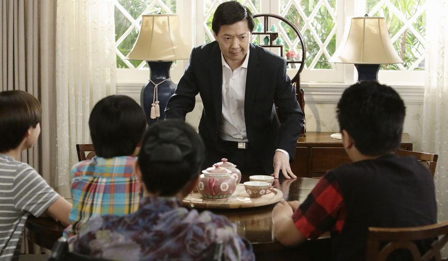 """In this image released by ABC, Ken Jeong, center, appears in a scene from, """"""""Fresh Off The Boat."""" Jeong guest stars on the season finale airing Tuesday, May 24, on ABC. (Nicole Wilder/ABC via AP)"""