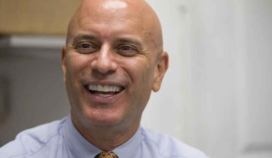 FILE - In this April 6, 2016 file photo, Tim Canova smiles as he speaks during an interview at his campaign headquarters in Hollywood, Fla. Canova, a university law professor running his first political campaign, announced Monday, May23, 2016, that he raised more than $250,000 after Sanders endorsed his campaign over the weekend. Despite the dollars flowing into his campaign coffers, Canova faces a tough fight to defeat Democratic National Committee chairwoman Debbie Wasserman Schultz.   (AP Photo/Wilfredo Lee, File)