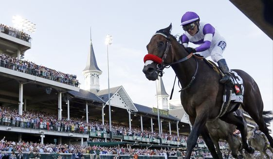 """FILE - In this May 7, 2016, file photo, Mario Gutierrez rides Nyquist to victory during the 142nd running of the Kentucky Derby horse race at Churchill Downs in Louisville, Ky. The trainer of Nyquist says the Kentucky Derby winner is sick and won't run in the Belmont Stakes on June 11. Doug O'Neill said Tuesday, May 24, 2016,  that Nyquist is """"out because of sickness."""" (AP Photo/David J. Phillip, File)"""