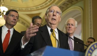 Senate Majority Leader Sen. Mitch McConnell of Ky., speaks during a news conference on Capitol Hill in Washington, Tuesday, May 24, 2016. From left are, Sen. John Barrasso, R-Wyo., Sen. John Thune, R-S.D., McConnell, and Senate Majority Whip John Cornyn of Texas. (AP Photo/Evan Vucci) ** FILE **