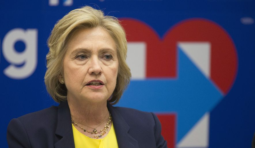 Democratic presidential candidate Hillary Clinton participates in a round-table discussion with HIV/AIDS activists at her campaign headquarters in New York, in this May 12, 2016, file photo. (AP Photo/Mary Altaffer, File)