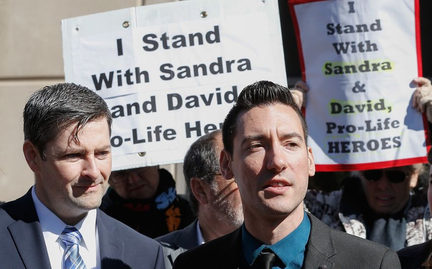 Pro-life activist David Daleiden speaks to supporters outside the Harris County Criminal Courthouse after turning himself in to authorities on Feb. 4 in Houston. (Associated Press)
