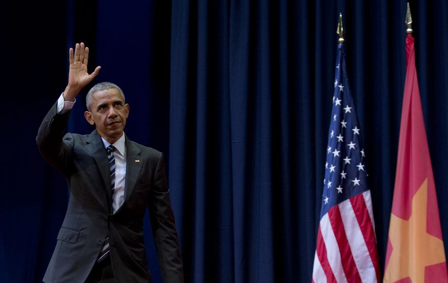 President Obama waves Tuesday as he leaves the stage after speaking at the National Convention Center in Hanoi, Vietnam. (Associated Press)