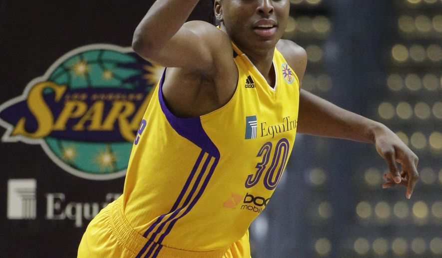 FILE - In this Sept. 3, 2015, file photo, Los Angeles Sparks' Nneka Ogwumike reacts after making a basket during the first half of a WNBA basketball game against the Washington Mystics, in Los Angeles. What a difference a year makes. The Sparks are 3-0 for the first time since 2003 after rallying from an eight-point deficit in the final 80 seconds on Saturday against the New York Liberty to win in overtime. The Sparks didn't win their third game last season until July 21. (AP Photo/Jae C. Hong, File)