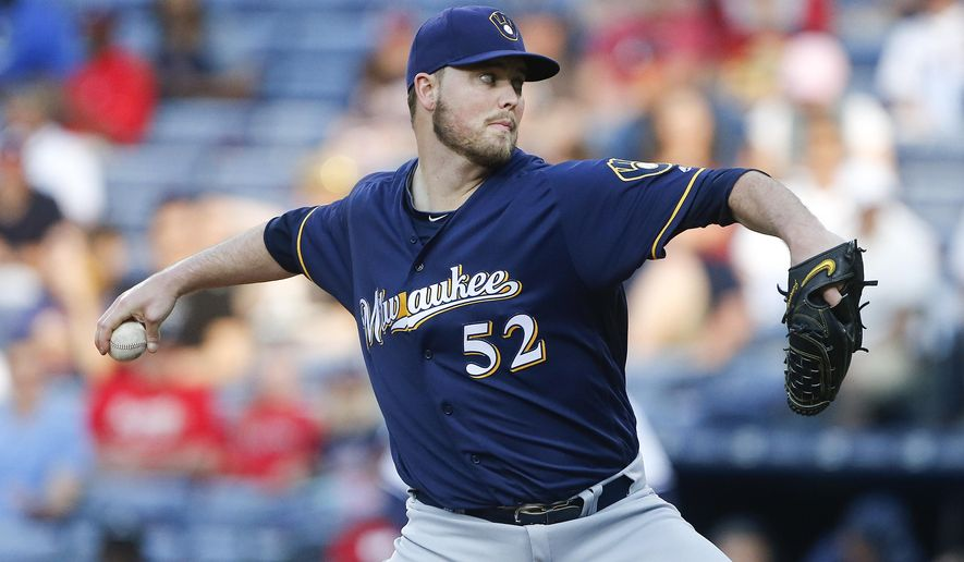 Milwaukee Brewers starting pitcher Jimmy Nelson (52) delivers in the first inning of a baseball game against the Atlanta Braves on Tuesday, May 24, 2016, in Atlanta. (AP Photo/John Bazemore)