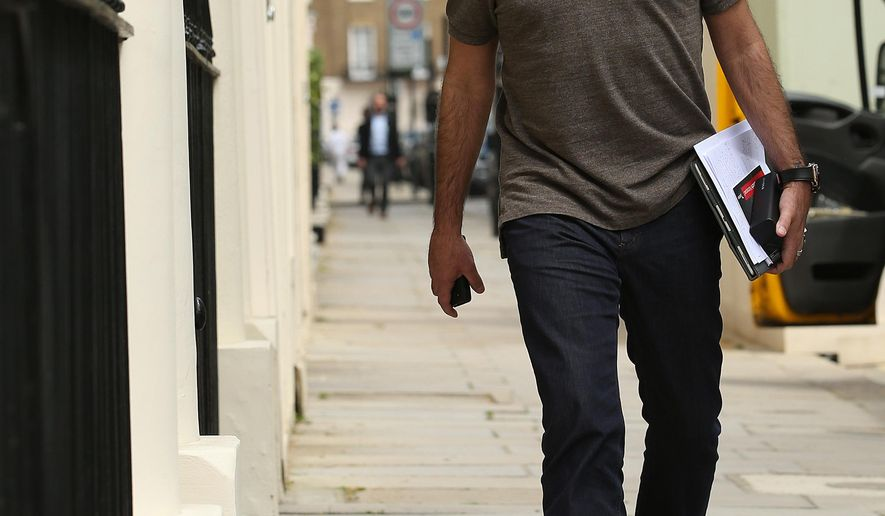 Jose Mourinho walks outside his house in central London, Tuesday May 24, 2016. Manchester United is looking for its third manager since Ferguson's trophy-laden 26-year dynasty ended in 2013 after firing Louis van Gaal on Monday following months of uncertainty around his position. Jose Mourinho is set to take over at Old Trafford as the latest coach attempting to revive the fortunes of England's biggest club. (Steven Paston/PA via AP) UNITED KINGDOM OUT