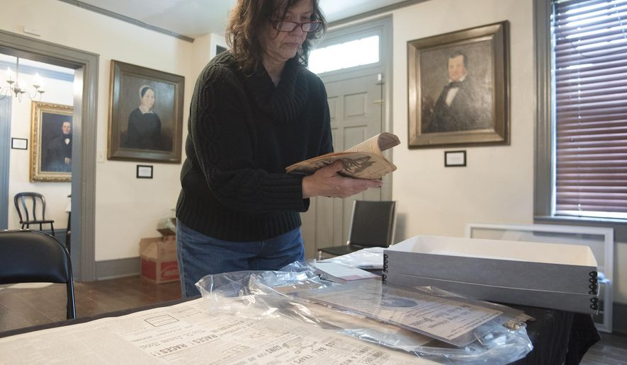 "In a May 3, 2016 photo, Christine Buckelew, president of the Fayette County Historical Society, prepares for the latest museum exhibition on the infamous Nutt murder case from the 1800's in Uniontown, Pa. The story is being retold at the historical society in a new exhibit called ""An American Tragedy"" at the Abel Colley Tavern and Museum, located in Menallen Township on Route 40. (Rebecca Devereaux /Herald-Standard via AP) MANDATORY CREDIT (REV-SHARE)"