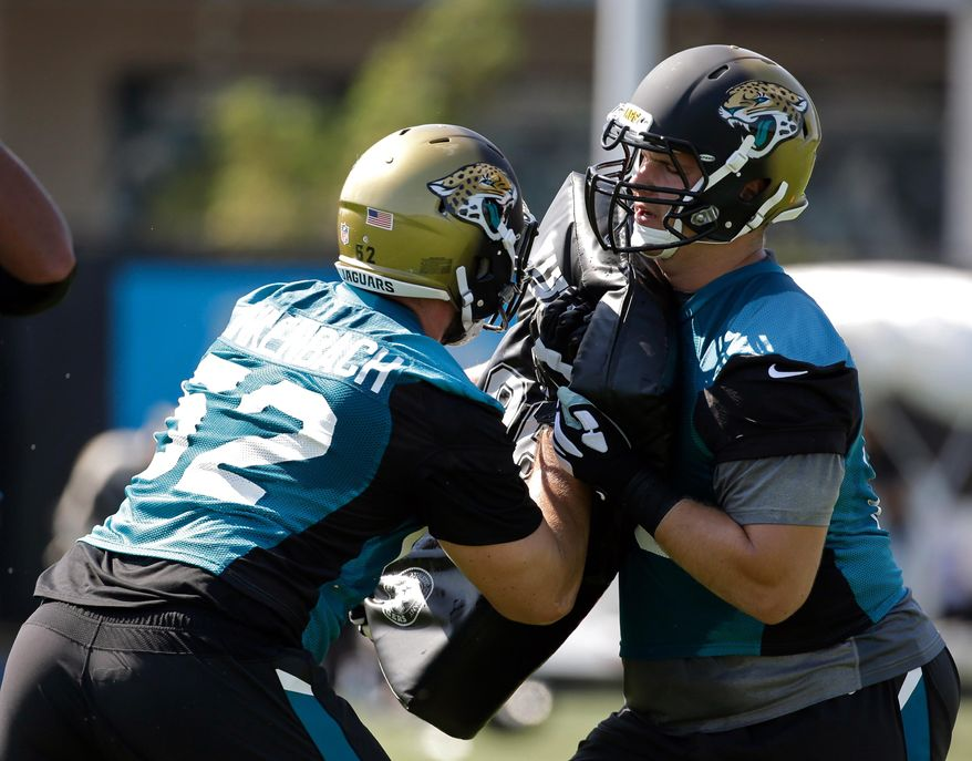 Jacksonville Jaguars offensive lineman Jeff Linkenbach (62) and tackle Luke Joeckel go through a drill during an NFL football practice, Monday, May 23, 2016, in Jacksonville, Fla. (AP Photo/John Raoux)