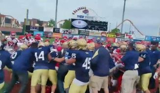 A charity football game between New York City's police and fire departments devolved into an all out brawl Sunday after a verbal dispute escalated on the field. (NBC New York)