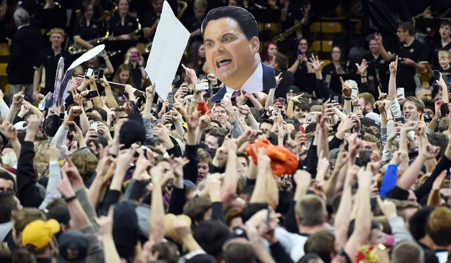 FILE - In this Feb. 24, 2016, file photo, Colorado fans storm the court after Colorado defeated Arizona 75-72 in an NCAA college basketball game in Boulder, Colo. The Pac-12 CEO Group on Tuesday, May 24,2 016,  has approved provisions to reduce night football games, add fines for court and field storming, and begin eSports competitions in 2016-17. (AP Photo/Cliff Grassmick, File)
