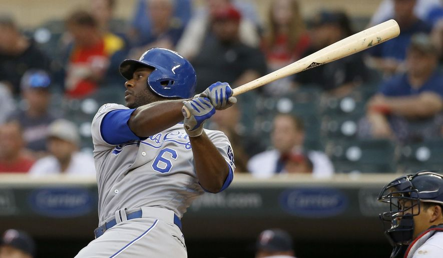 Kansas City Royals' Lorenzo Cain (6) follows through on a one-run double off Minnesota Twins starting pitcher Ricky Nolasco during the first inning of a baseball game in Minneapolis, Monday, May 23, 2016. (AP Photo/Ann Heisenfelt)
