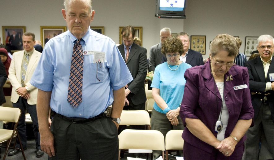 FILE - In this Sept. 24, 2010 file photo, Anthony Bruner and Mary Lou Bruner, right, pray at the start of a meeting of the Texas State Board of Education to discuss Islam and Christianity in textbooks in Austin, Texas. Mary Lou Bruner, a retired Texas schoolteacher who claims President Barack Obama is a gay prostitute is the Republican front-runner in a primary runoff for a seat on the influential state education board. Bruner is back on the ballot Tuesday, May 24, 2016, after nearly clinching the Republican nomination outright in March. (Jay Janner/Austin American-Statesman via AP, File)  AUSTIN CHRONICLE OUT, COMMUNITY IMPACT OUT, INTERNET AND TV MUST CREDIT PHOTOGRAPHER AND STATESMAN.COM, MAGS OUT; MANDATORY CREDIT