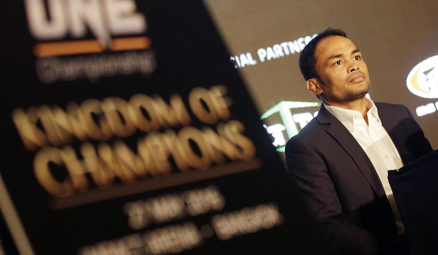 In this March 3, 2016 photo, One Championship Strawweight champion Dejdamrong Amnuaysirichoke attends a press conference for his upcoming Mixed Martial Arts, MMA, match in Bangkok, Thailand. Thailand will host its first major MMA event on Friday, May 27, 2016 despite the country's traditional Muay Thai kickboxing style being the foundation of its fighting technique. (AP Photo/Sakchai Lalit)