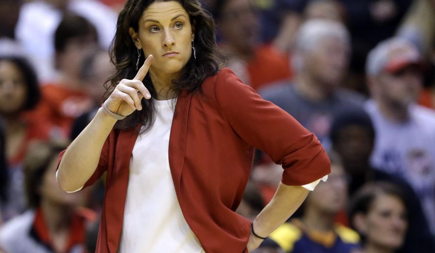 FILE - In this Oct. 11, 2015, file photo, Indiana Fever head coach Stephanie White watches from the sidelines in the first half of Game 4 of the WNBA Finals basketball series against the Minnesota Lynx,  in Indianapolis. Vanderbilt has hired Stephanie White of the WNBA's Indiana Fever as its women's basketball coach. The university announced the hiring Tuesday, May 24, 2016, and White will be introduced at a news conference Wednesday. (AP Photo/Michael Conroy, File)