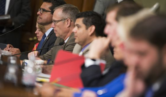 Puerto Rico's Resident Commissioner Pedro Pierluisi, D-Puerto Rico, second from left, listens on Capitol Hill in Washington, Wednesday, May 25, 2016, during a House Natural Resources Committee markup hearing on H.R. 5278, Puerto Rico Oversight, Management, and Economic Stability Act. (AP Photo/Evan Vucci)