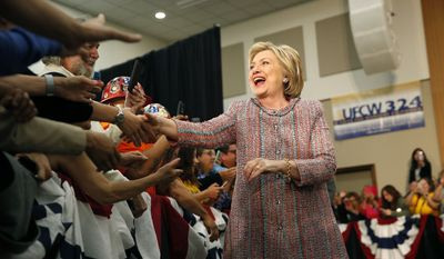Democratic presidential candidate Hillary Clinton greets supporters at a rally at a United Food and Commercial Workers International Union hall, Wednesday, May 25, 2016, in Buena Park, Calif. (AP Photo/John Locher)
