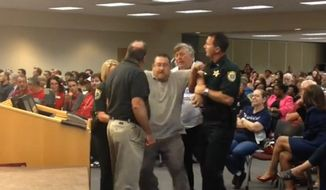 Brevard County School Board candidate Dean Paterakis was carried out of a public meeting by police Tuesday night after he was accused of using inappropriate language while discussing the district's transgender bathroom policy.