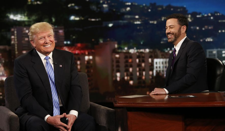 """In this photo provided by ABC, Republican presidential candidate, Donald Trump, left, talks with host Jimmy Kimmel during a taping of the ABC television show, """"Jimmy Kimmel Live!,"""" on Wednesday, May 25, 2016, in Los Angeles. Trump made an appearance as a guest, along with musical guest Greg Porter on the late night show, which airs every weeknight at 11:35 p.m. EST. (Randy Holmes/ABC via AP)"""