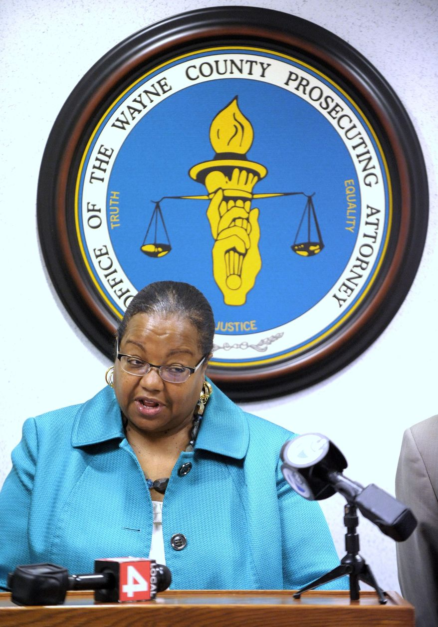 Wayne County Prosecutor Kym Worthy announces charges against individuals involved in the gun violence deaths of children in Detroit, Wednesday morning, May 25, 2016.  (Todd McInturf, The Detroit News via AP)