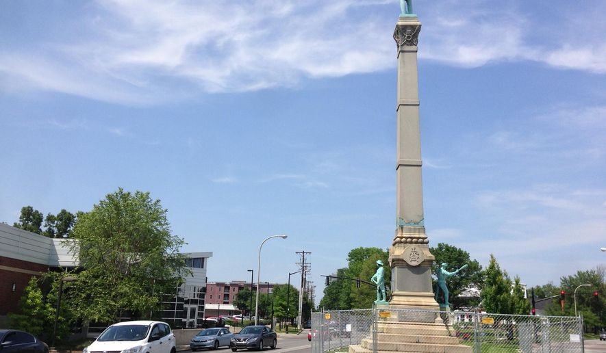 In this Tuesday, May 24, 2016 photo, a stone monument to Confederate soldiers killed in the Civil War sits near the University of Louisville in Louisville, Ky. A judge has ended a restraining order that barred the city of Louisville from removing the 120-year-old monument to Confederate soldiers. (AP Photo/Dylan Lovan)
