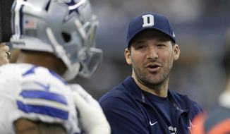 FILE - In this Jan. 3, 2016, file photo, Dallas Cowboys' Tony Romo talks with teammates on the sideline during the first half of an NFL football game against the Washington Redskins in Arlington, Texas. Romo is practicing for the first time since before last year's Thanksgiving loss to Carolina, when he broke his left collarbone for the second time in 2015. (AP Photo/Tim Sharp, File0