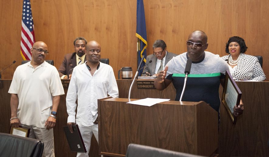 Kevin Saunderson, right, gives a short speech as he and fellow Detroit techno music pioneers, from left, Eddie Fowlkes and Juan Atkins were honored by the Detroit City Council on Tuesday, May 24 , 2016, in Detroit. The Council presented Testimonial Resolutions and Spirit of Detroit Awards to the following individuals and organizations: Atkins, Derrick May, Saunderson, Fowlkes, John Collins, Underground Resistance and the Submerge Techno Museum, Movement Electronic Music Festival, Kelli Hand, Carl Craig, Jeff Mills, and Paxahau Events. (John T. Greilick/Detroit News via AP)  DETROIT FREE PRESS OUT; HUFFINGTON POST OUT; MANDATORY CREDIT