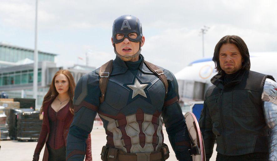 "This image released by Disney shows Elizabeth Olsen, left, Chris Evans and Sebastian Stan in a scene from Marvel's ""Captain America: Civil War.""  (Disney/Marvel via AP) ** FILE **"