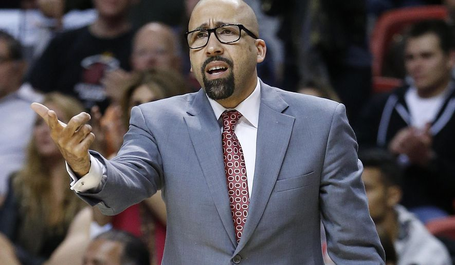 FILE - In this Nov. 2, 2014, file photo, Miami Heat assistant coach David Fizdale gestures during the team's NBA basketball game against the Toronto Raptors in Miami. A person with knowledge of the negotiations says the Memphis Grizzlies have offered their head coaching job to Fizdale. The person says Fizdale met with Grizzlies controlling owner Robert Pera on Wednesday, May 25, in California and that the job had been offered. The person spoke to The Associated Press on condition of anonymity because the Grizzlies are not commenting on specific candidates in their coaching search. (AP Photo/Joel Auerbach, File)
